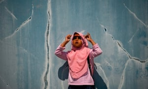A child watches the moon move in front of the sun in Banda Aceh
