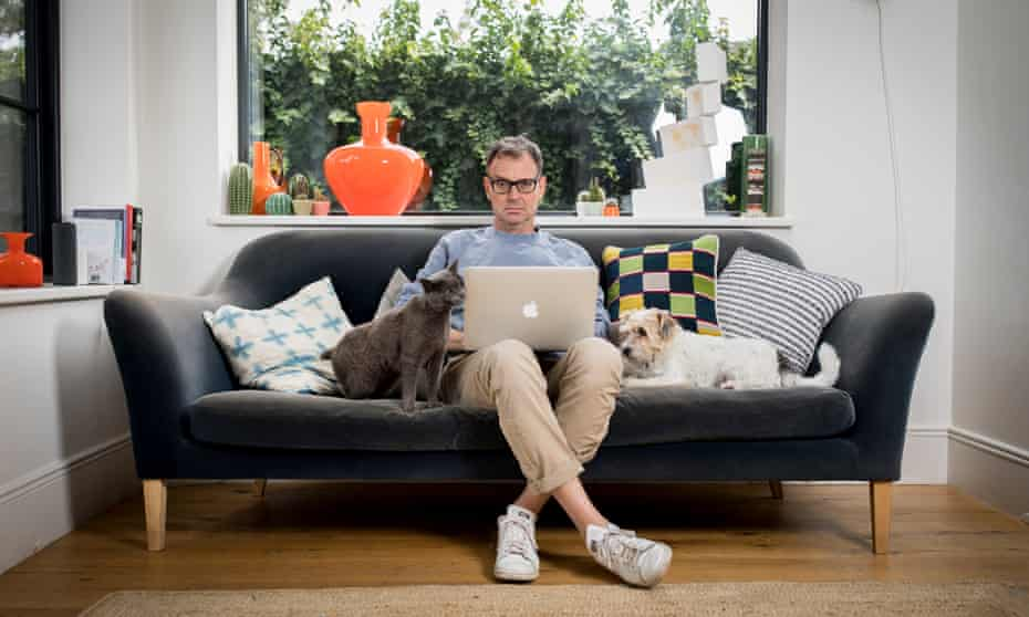Tim Dowling at home with his dog, Nelly, and cat, James.
