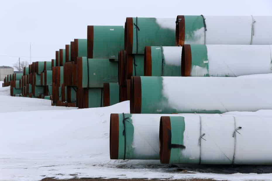 Pipes for the planned Keystone XL oil pipeline lie in the snow in Gascoyne, North Dakota, in 2017. Biden has ditched the project in a highly symbolic move.