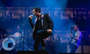 Ronnie Vannucci, Brandon Flowers, and Mark Stoermer of The Killers performs a surprise concert