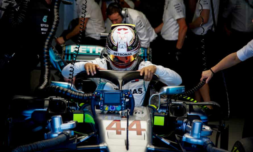Lewis Hamilton emerges from his Mercedes at the end of the first practice session for the Australian Grand Prix at Melbourne.
