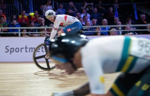Great Britain's Matthew Walls keeps an eye on Australia's Sam Welsford during the men's scratch race