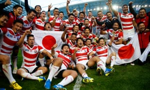 Japan players celebrate their momentous victory against South Africa in the 2015 World Cup in England.
