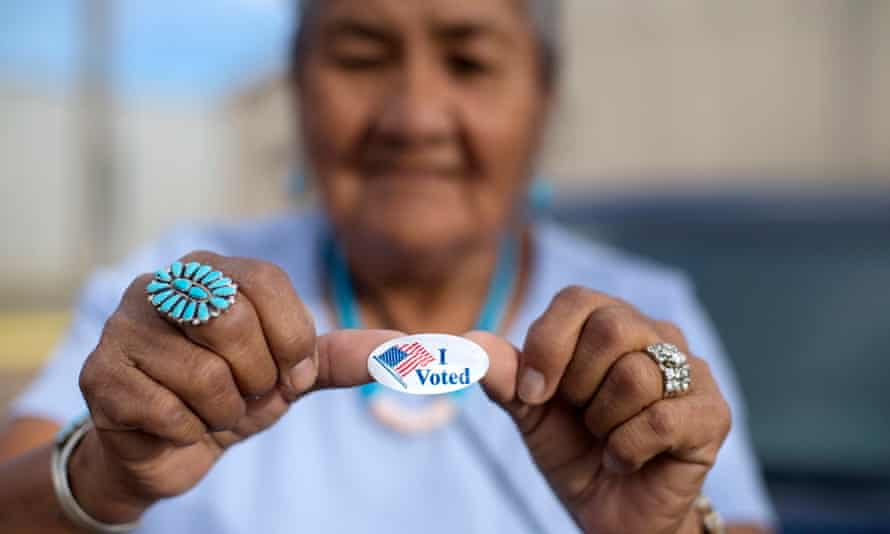 A woman shows off her 'I voted' sticker in Window Rock, Arizona, in August 2018.