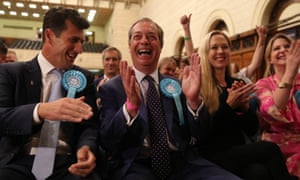 Brexit party leader Nigel Farage (centre) celebrates being elected to the European parliament.