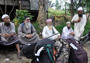 Muslim missionaries called 'Tablighi' are seen with their belongings as they await transport out of Marawi