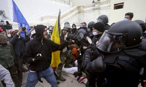 The rioters try to break through a police barrier on January 6 at the Washington Capitol.