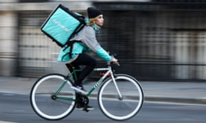 A cyclist delivers food for Deliveroo in London. A quarter of gig economy workers earn less than the mandatory £7.50 per hour, government research shows.