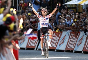Alaphilippe celebrates as he crosses the finish line.