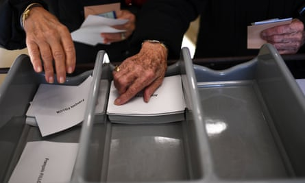 Voters selecting ballots in French primary election