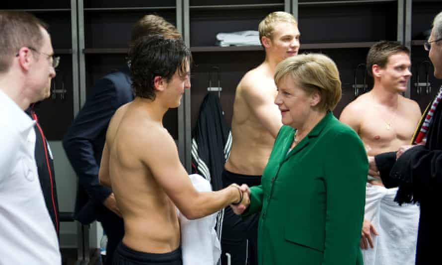 Mesut Özil meets the Germany chancellor Angela Merkel after the match against Turkey in Berlin in 2010.