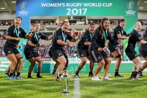 The joyous and victorious New Zealand players, sporting their winners' medals, perform the Haka as they celebrate regaining the World Cup