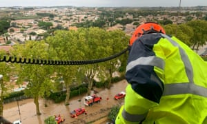 A rescue team flying over flooded areas near Béziers in helicopter