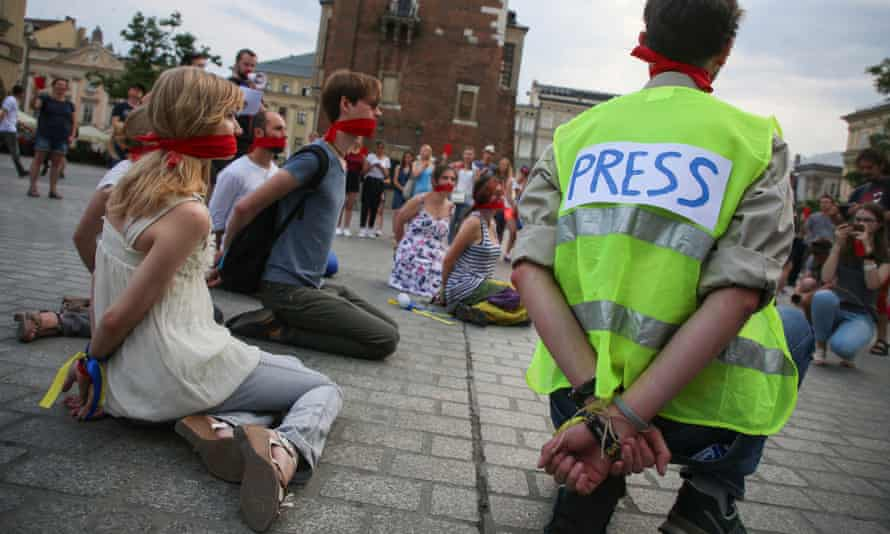 Protesters in the Polish city of Krakow demand the release of Ukrainian film director Oleg Sentsov, who was jailed by a Russian military court in 2015 on charges of terrorism