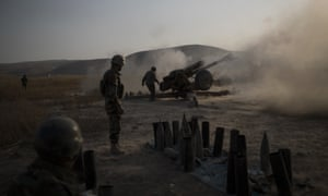 Kurdish Peshmerga soldiers fire artillery at Islamic State positions in Bashiqa.
