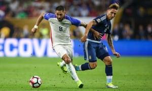 Clint Dempsey battling against Lucas Biglia during Tuesday's semi-final match against Argentina.