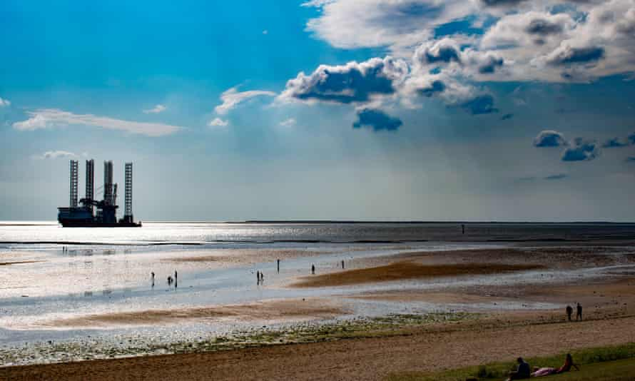 Panorama of Esbjerg oil harbor, Denmark, oil rig on the shore of Nord see, summer 2019.