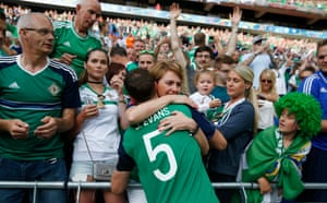 Jonny Evans celebrates with fans at the end of the match.