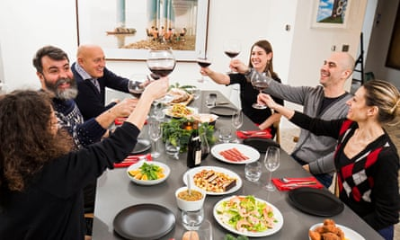 Chef Nuno Mendes and guests enjoy a traditional Portuguese festive spread
