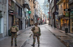Belgian soldiers patrol in Rue Neuve, normally the busiest shopping street in Brussels