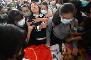 The mother of Khant Nyar Hein reacts at his funeral. The first-year medical student was shot by security forces as he protested