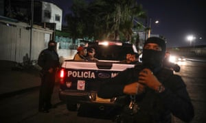 Municipal police detain suspects of selling or carrying drugs in the northern part of Tijuana, Mexico. Photograph: Emilio Espejel/The Guardian