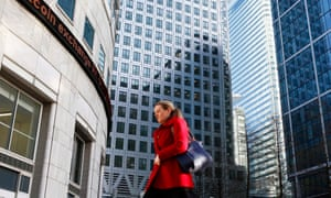 A woman walks to work in Canary Wharf, London