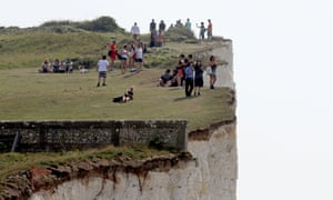People on the cliffs at Birling Gap, Eastbourne, East Sussex, part of a stretch of coastline that was evacuated after a chemical 'haze' of unknown origin, that left dozens of holidaymakers with streaming eyes, sore throats and vomiting