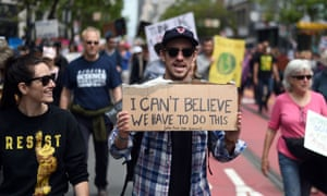 "People holds up signs during the March for Science in San Francisco, California on April 22, 2017. Thousands of people joined a global March for Science to fight back against what many see as an ""assault on facts"" by populist politicians."
