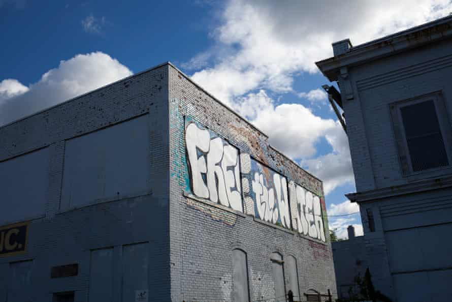 """A commissioned mural painted by Antonio Cosme, one of two Detroit artists who went to trial for painting """"Free the Water"""" on one of Detroit's water towers."""
