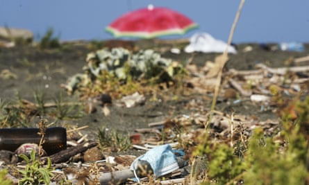 A face mask on a rubbish-strewn beach in Fiumicino, near Rome. Italy produced 10% less litter during its coronavirus lockdown.