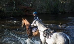Horse Rider at Tarr Steps, in Autumn, Exmoor National Park, UK