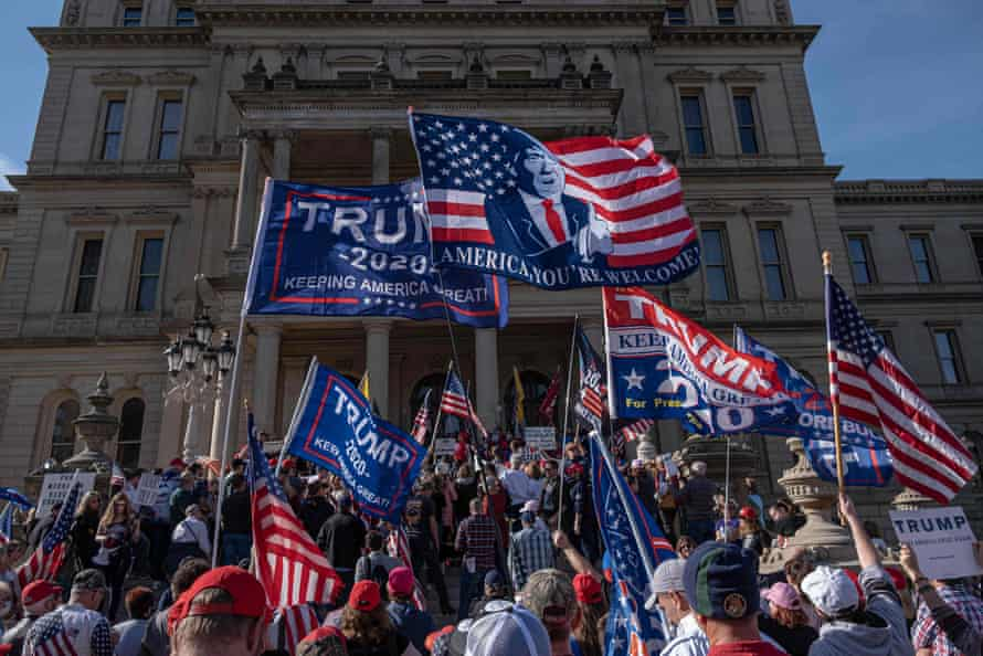 Donald Trump supporters rally at the state capitol in Lansing, Michigan, on Saturday.