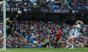 City take on United at Manchester's Etihad stadium, watched by a record crowd.