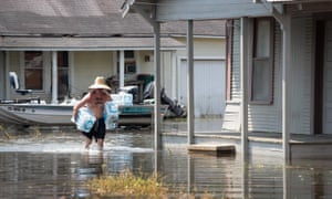 A volunteer help to pass out water to flood victims after torrential rains pounded southeast Texas following Harvey.