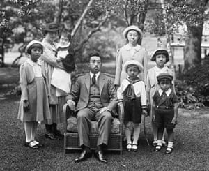 Japan's former Emperor Hirohito (C) poses for photographs with family members, including the current Akihito (front, 2-R) at the Imperial Palace in Tokyo in October 1939