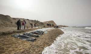 Red Crescent volunteers recovering bodies washed ashore at the coast near Zawiya,