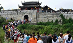 Tourists at the gateway to Qingyan on a national holiday.