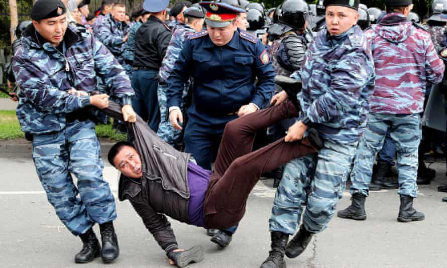 Police haul away a protester
