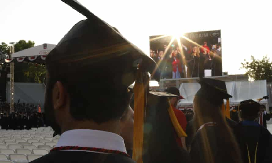 Students graduate at the University of Georgia. Swastikas were recently drawn on message boards at the university.