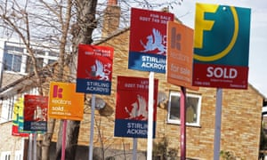 Estate agents' signs outside a house