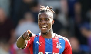 Wilfried Zaha will come up against former teammate Wan-Bissaka at Old Trafford.