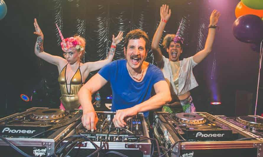 Publicity image for the Mighty Hoop-la weekender with a DJ on the decks and two friends partying.