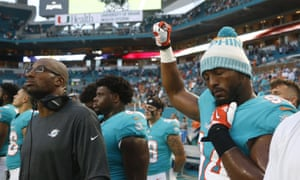 Miami Dolphins defensive end Robert Quinn (94) raises his right fist during the singing of the national anthem