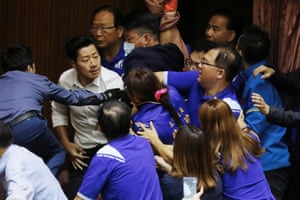 The voting went ahead despite shouting and protests from the KMT