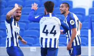 Brighton & Hove Albion's Neal Maupay (right) celebrates scoring their second goal with teammates .