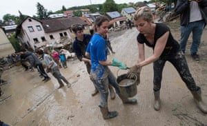Braunsbach, southern Germany People form a human chain to remove water in buckets from flooded houses