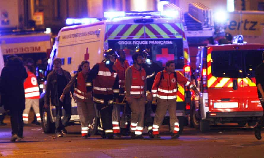 Rescue workers evacuate an injured person on Rue de Charonne.
