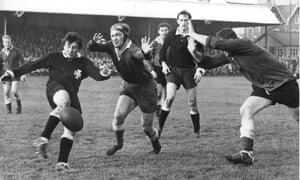 Neath's Martin Davies gets his kick away under pressure against Llanelli at the Gnoll in 1963. The sides meet again on Friday, providing Neath survive their court date.