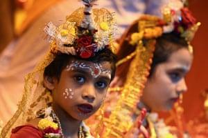Girls dressed as the Hindu goddess Durga